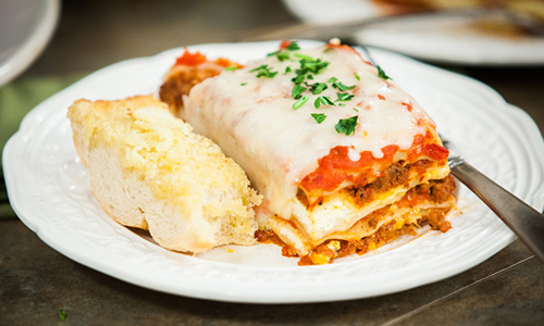 Slow Cooked Lasagna with Cheesy Garlic Bread | The Sacred Olive